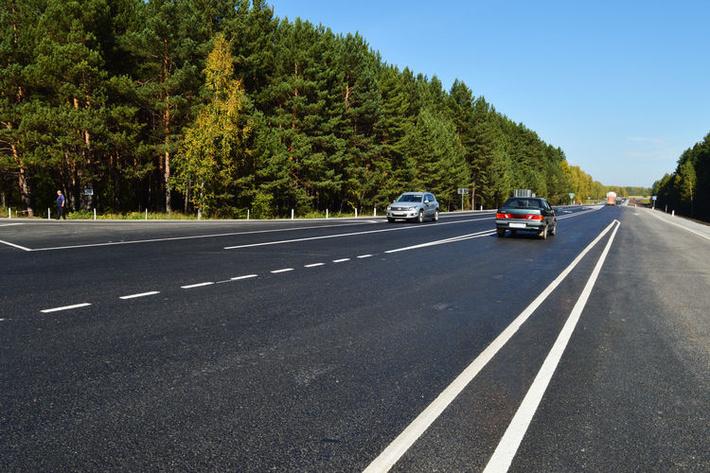 В Кемеровской области федеральные дорожники завершили капитальный ремонт участка автодороги на подъезде к Томску